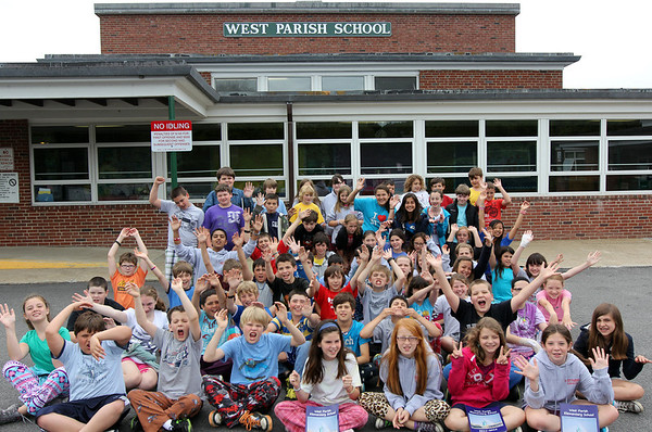 ALLEGRA BOVERMAN/Staff photo. Gloucester Daily Times. Gloucester: The 67 members of the fifth grade at West Parish Elementary School raised money during the school year and had a new sign made for the front of the school. They raised over $7,000 during the year during their various fundraisers, spending a portion of it for the sign. Cheryl Newman-Lahti of West Gloucester, of Cheryl's Signs, put up the sign.