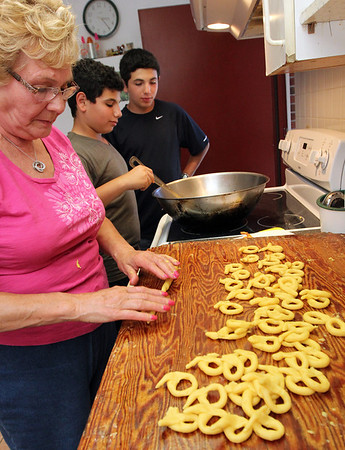 ALLEGRA BOVERMAN/Staff photo. Gloucester Daily Times. Gloucester: Grace Ciaramitaro of Gloucester loves to bake. She was making fried-dough treats with her grandsons Joey Giacalone and Vincent Giacalone, 12 and 13, respectively, of Gloucester, on Monday afternoon at her house.