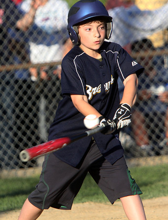 Allegra Boverman/Staff photographer. Gloucester Daily Times. Gloucester:<br /> Luke Walkama of the Brewers participates in the 9-year-old portion of the home run derby during the Seventh Annual Gloucester Little League Family Picnic and Skills night held at Boudreau Field on Friday evening.