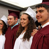 ALLEGRA BOVERMAN/Staff photo. Gloucester Daily Times. Rockport: From left are friends Kaylee Stanton, Mark Foote, Jr., Rachel Rowe and Chris Beal, at Rockport High School's commencement on Friday evening at the school. Stanton will attend University of Rhode Island for marine biology, Foote will  attend North Shore for criminal justice, Rowe will attend University of Vermont for exercise movement science and Beal will attend Wallace Community College for accounting.