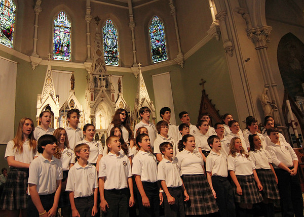 """ALLEGRA BOVERMAN/Staff photo. Gloucester Daily Times. Gloucester: St. Ann School of Cape Ann students performed their concert titled """"Let the Music Take You!"""" during their """"Celebration of the Arts,"""" held on Thursday at the school and the church. There was also an art exhibit in the school gymnasium and hallway. The choral performance was featuring Betsy Smentek and accompanist Michael Becker The music instruction at the school is through the Urban Voices program of the Metropolitan Opera Guild."""