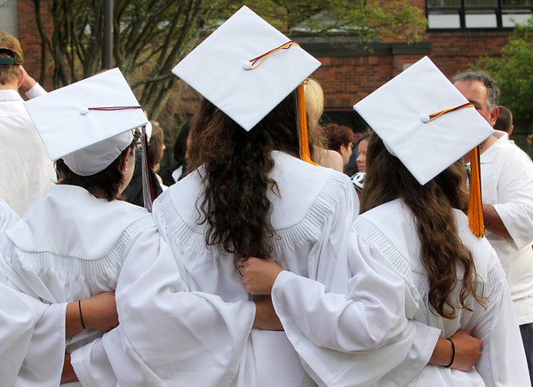 ALLEGRA BOVERMAN/Staff photo. Gloucester Daily Times. Rockport: Posing for photos right before Rockport High School's commencement on Friday evening at the school.