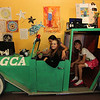 "ALLEGRA BOVERMAN/Staff photo. Gloucester Daily Times. Gloucester: The Gloucester Community Arts Charter School now has a fancy ""art car"" parked in the main lobby. It was a prop from a 2007 production of ""Crazy for You"" by the North Shore Music Theater and is a 16-foot long wood replica of a Rolls Royce. The roof is reinforced so it can be danced upon and five adults can fit inside it. The car has been gussied up by Charter School students and they can read, write, draw, act, play and hang out in it. Gordon Baird, on the board of trustees of the school, donated it to the school. Hanging out in it on Thursday are, in front, fourth graders Lillie Favazza, back, and Maddy Currier, and at right, fifth grader Emma Killian."