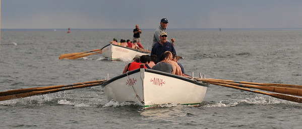 Gloucester: One of the crews manning the Nina finishes strong just ahead of it's opponent at the Seine boat eliminations on Pavilion Beach Wednesday night. Jim Vaiknoras/staff photo