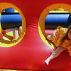 ALLEGRA BOVERMAN/Staff photo. Gloucester Daily Times. Gloucester: Emily Johnson, 3, plays in a bounce house during the Open Door Food Pantry Summer Lunch program held at Riverdale Park on Veterans Way on Friday afternoon.