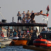 ALLEGRA BOVERMAN/Staff photo. Gloucester Daily Times. Gloucester: Ross Carlson reaches the flag and won the third round of the Friday Greasy Pole event.