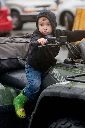 Manchester: Zachary Welch, 3, tries out of or the police ATVs during Truck Night in Town Hall Parking Lot in Manchester Tuesday night. The rainy evening gave residence an opportunity to check out Police, Fire and DPW vehicles and meet the people who use them. jim Vaiknoras/staff photo