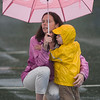 Manchester: Emery Davis, 2, gives his mom Megan a hug in the rain during Truck Night in Town Hall Parking Lot in Manchester Tuesday night. The rainy evening gave residence an opportunity to check out Police, Fire and DPW vehicles and meet the people who use them. jim Vaiknoras/staff photo