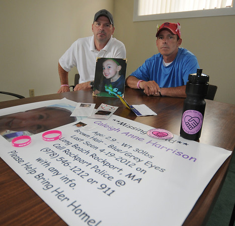 Gloucester : David Harrison and Anthony Harrison with photograph of Anthony's missing daughter Caleigh and items they will have at an information booth at Fiesta this weekend. JIm Vaiknoras/staff photo