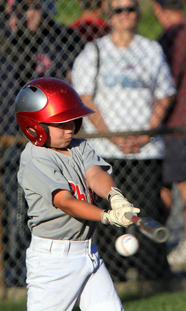 Allegra Boverman/Staff photographer. Gloucester Daily Times. Gloucester: <br /> Richie Williams of the Phillies participates in the 9-year-old portion of the home run derby during the Seventh Annual Gloucester Little League Family Picnic and Skills night held at Boudreau Field on Friday evening.