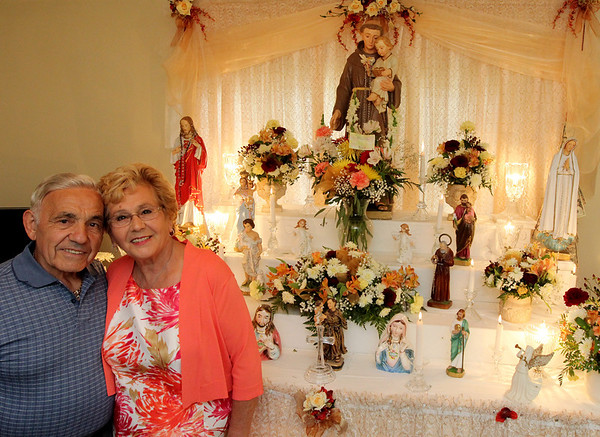 ALLEGRA BOVERMAN/Staff photo. Gloucester Daily Times. Gloucester: Nino and Grace Ciaramitaro of 13 Apple St. in Gloucester are celebrating their 40th year of honoring St. Anthony on the saint's birthday, June 13. They are busy preparing for the mass, food, bread and festivities and hold the mass at their house at 4 p.m. on Wednesday. They hold services at their house at this altar that they set up each year, starting June 1 through June 13 to lead up to the birthday. St. Anthony is the patron saint for lost things.