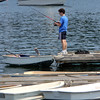 ALLEGRA BOVERMAN/Staff photo. Gloucester Daily Times. Manchester: Nico Gillespie of Manchester, 16, fishes off Tuck's Point on Friday afternoon. He loves fishing and hopes that over the summer he and his family can take a chartered fishing trip.