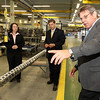 ALLEGRA BOVERMAN/Staff photo. Gloucester Daily Times. Gloucester: Gloucester Engineering Vice President of Project Management Lloyd Rothaus, right, talks with Sen. Bruce Tarr, center, and State Rep. Ann-Margaret Ferrante about the products they are making at the Gloucester plant on Friday morning.