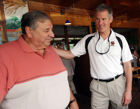 ALLEGRA BOVERMAN/Staff photo. Gloucester Daily Times. Gloucester: U.S. Sen. Scott Brown, right, visits Lobsta Land in Gloucester on Saturday with Vito Calomo, of Gloucesterthe community outreach fisheries specialist for Brown's office, and other local leaders.