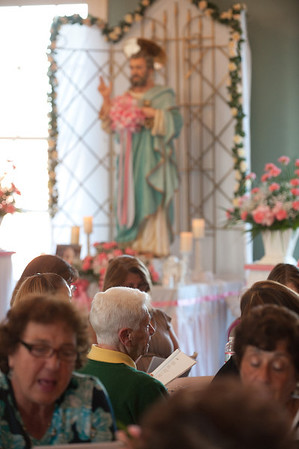 DESI SMITH/Staff photo. Gloucester Daily Times. Gloucester: Sara Favazza, seated center, at the St. Peter's Novena.