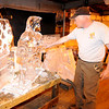 Gloucester: Steve Scatterday an employee at Cape Pond Ice Company shows off some of the ice scultures made at in the ice house, with temperatures in the 90's this week, the workers at Cape Pond really do have the coolest jobs in town. JIm Vaiknoras/staff photo