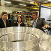 ALLEGRA BOVERMAN/Staff photo. Gloucester Daily Times. Gloucester: Gloucester Engineering Vice President of Project Management Lloyd Rothaus, far right, talks with Sen. Bruce Tarr, left, and State Rep. Ann-Margaret Ferrante about the products they are making at the Gloucester plant on Friday morning.