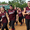 ALLEGRA BOVERMAN/Staff photo. Gloucester Daily Times.  Lowell: Rockport players including senior Kendra Adams, far right, walk off the field after their game against St. Mary's in the Division III North Semifinals held in Lowell on Friday afternoon. They lost 8-1.