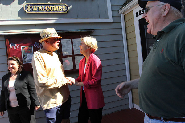 Allegra Boverman/Staff photographer. Gloucester Daily Times. Gloucester: Elizabeth Warren, center right, Democratic candidate for U.S. Senate, talks with, Michael Stevens, a new resident of Gloucester, center left, as his cousin, far right, Matt Stevens, of Manchester, N.H., looks on, at Gloucester House Restaurant on Friday afternoon. State Rep. Ann-Margaret Ferrante is at far left. They were meeting with fishermen at the restaurant.
