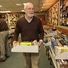 ALLEGRA BOVERMAN/Staff photo. Gloucester Daily Times. Gloucester: Preparing for the annual Friends Book Sale at the Sawyer Free Library on Wednesday. Front, right, is Dennis Corkery. Behind him, at left, is Peter Jenner. The Friends sale is Friday and Saturday from 9 a.m. - 4 p.m. both days, and on Thursday from 4-7 p.m. only, a sale for Friends only.