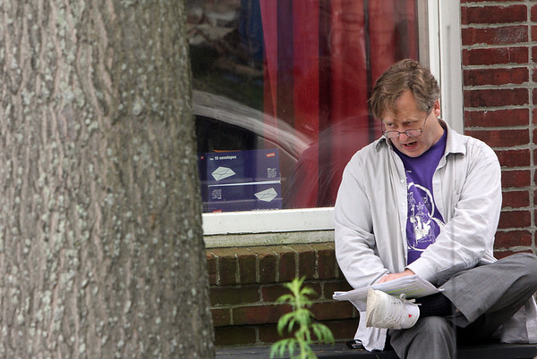 """ALLEGRA BOVERMAN/Staff photo. Gloucester Daily Times. Gloucester: Actor Steve Barkhimer of Boston rehearses his lines outdoors before rehearsal on Wednesday afternoon for """"Round and Round the Garden, which will be performed at the Gloucester Stage Company. He has been participating in productions there for the last three summers."""