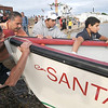 Gloucester: Mike Galante , Anthony Giacolone, and Anthony's sons Vincent and Joey launch the Santa Maria at the Seine boat eliminations on Pavilion Beach Wednesday night. The crew in the boat consisted of 7 named Giacolone. Jim Vaiknoras/staff photo
