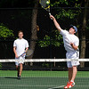 Reading: Manchester-Essex's Collin Babikian goes up for a shot as his partner Ben Scarafoni guards the baseline during their 1st doubles match  with Austin Prep's Jason Carrier and Stratton Stillianos  at Austin Prep in Reading. Jim Vaiknoras