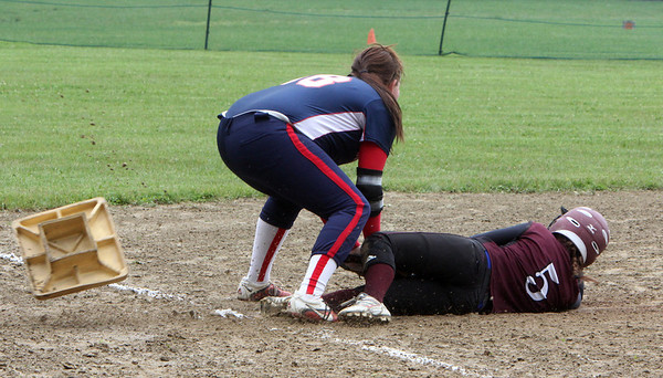 ALLEGRA BOVERMAN/Staff photo. Gloucester Daily Times. Rockport: Rockport's Hannah Lorden, right, slides into third base, knocking it out of the ground, as North Shore Tech's Alyssa King tries to tag her during their game in Rockport on Sunday afternoon.