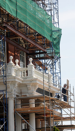 Gloucester: A workerworks on the front of Gloucester City Hall during the building extensive renovations. Jim Vaiknoras/staff photo