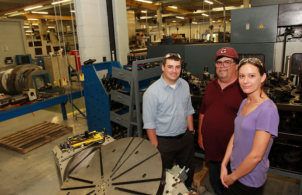 ALLEGRA BOVERMAN/Staff photo. Gloucester Daily Times. Gloucester: Members of the Marchant Family of Gloucester work at Gloucester Engineering. From left are Jimmy Marchant, Jr., a staff accountant, his father Jim Marchant, the building and machine repair technician, and his daughter Alicia Marchant, a CNC programmer.