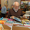 ALLEGRA BOVERMAN/Staff photo. Gloucester Daily Times. Gloucester: Preparing for the annual Friends Book Sale at the Sawyer Free Library on Wednesday. Front, center, is Dennis Corkery. Behind him, from left, are: Rosella Sagall, Christy Park and Betty Nicastro, sorting books for the Children's Room sale, which will start along with the Friends sale, but last until all the books are gone. The Friends sale is Friday and Saturday from 9 a.m. - 4 p.m. both days, and on Thursday from 4-7 p.m. only, a sale for Friends only.