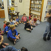 Essex: Greg Nikitas teaches about the enviroment during the  Great Big Planet presentation at the Essex Library Tuesday night.  Nikitas used tale of the Old West and stories of about farming to give a message about conservation and taking care of the planet. JIm Vaiknoras/staff photo