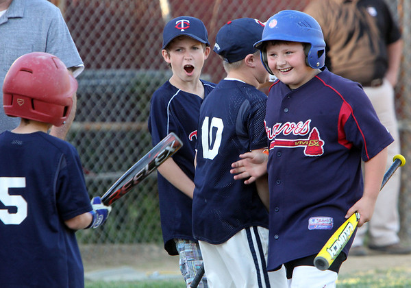 Allegra Boverman/Staff photographer. Gloucester Daily Times. Gloucester:<br /> Josh Concors, far right, reacts after he scored five home runs when he <br /> participated in the 9-year-old portion of the home run derby during the Seventh Annual Gloucester Little League Family Picnic and Skills night held at Boudreau Field on Friday evening.