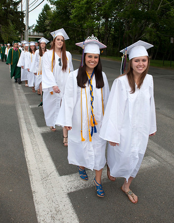 Manchester: Kathleyn Carr and Anya Ciarametaro make their way to Hyland Field for the Graduation Ceremony at Manchester Essex Regional High School Friday afternoon. Desi Smith/Gloucester Daily Times. June 1,2012