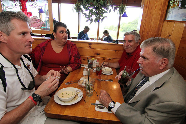 ALLEGRA BOVERMAN/Staff photo. Gloucester Daily Times. Gloucester: U.S. Sen. Scott Brown, left, has lunch at Lobsta Land with various local leaders from Cape Ann on Saturday. From left around him are: City Councilwoman Sefatia Romeo Theken, former seven-term Democratic State Rep. Tony Verga, who endorsed Brown, and City Councilman Bob Whynott.