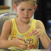 Gloucester: Lili Christopher, 6, makes a 10 piece ceramic puzzle at Art Haven's Young Artists Workshops in Gloucester. About 2 dozen kids participated in the workshop held at the  Main Street non-profit. JIm Vaiknoras/staff photo