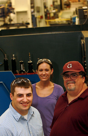 ALLEGRA BOVERMAN/Staff photo. Gloucester Daily Times. Gloucester: Members of the Marchant Family of Gloucester work at Gloucester Engineering. From left are Jimmy Marchant, Jr., his father Jim Marchant, who is a building and machine repair technician, and at center, back, Alicia Marchant, a CNC programmer.