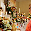 ALLEGRA BOVERMAN/Staff photo. Gloucester Daily Times. Gloucester: Grace and Nino Ciaramitaro of 13 Apple St. in Gloucester are celebrating their 40th year of honoring St. Anthony on the saint's birthday, June 13. They are busy preparing for the mass, food, bread and festivities and hold the mass at their house at 4 p.m. on Wednesday. They hold services at their house at this altar that they set up each year, starting June 1 through June 13 to lead up to the birthday. St. Anthony is the patron saint of lost things.