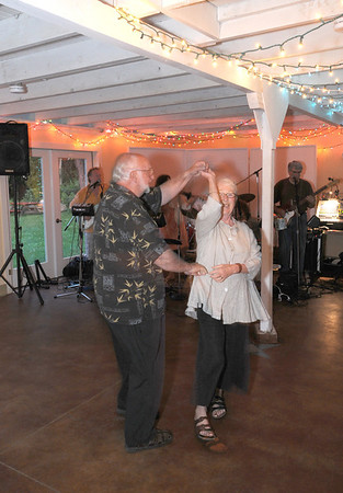 Gloucester: Bob and Sally Collini of Rockport take a spin on the dance floor at June Dance at Lanesville Community Center Saturday night. the event was a fundraser for the centers 60th Anniversary Capital Campaign. Jim Vaiknoras/staff photo