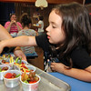 "ALLEGRA BOVERMAN/Staff photo. Gloucester Daily Times. Gloucester: During the ""Rainbow Warrior"" day at Veterans Memorial  Elementary School on Thursday, students sampled fruits and vegetables in a rainbow of colors and then charted their reaction to their taste, texture, crunch, juiciness and other criteria. Produce included grapes, peaches, cherry tomatoes and snow peas. The activity was part of the FoodCorps and CitySprouts food-related events that have been taking place all year at the school. Eve Kirvan-Stanley, a kindergartener, points out her favorite - grapes."