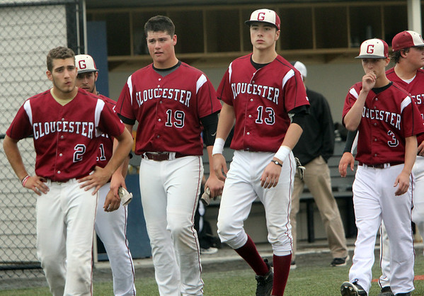 ALLEGRA BOVERMAN/Staff photo. Gloucester Daily Times. Salem: Gloucester players walk off the field after their 5-1 loss to Beverly at Salem State University on Tuesday afternoon. From left in front are: Santo Parisi, Michael Muniz, Alexander Webb and Devon Murray.