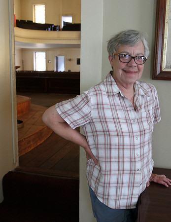 MARIAUMINSKI/GLOUCESTER DAILY TIMES Rev. Wendy Fitting stands in the Historical Room off of the sanctuary at the Unitarian Universalists Church in Gloucester. This sunday is Rev. Wendy's last in the pulpit after 24 years at the church.
