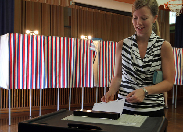 MARIAUMINSKI/GLOUCESTER DAILY TIMES Voter Erica Roark casts her ballot for the next Massachusetts US Senator at Veterans Memorial Elementary School on Tuesday June 25.
