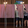 MARIAUMINSKI/GLOUCESTER DAILY TIMES Voters cast their ballot for the next Massachusetts Senator at Veterans Memorial Elementary School on Tuesday June 25. Though a low voter turn out was expected for the day, many polling spots were doing better than they had anticipated.