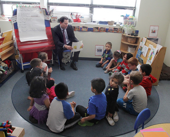 """MIKE SPRINGER/Staff photo  <br /> Congressman Seth Moulton reads """"Does Anyone Know Where a Hermit Crab Goes?"""" to pre-schoolers in the Head Start program during a visit Monday to Pathways for Children in Gloucester."""