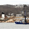 PAUL BILODEAU/Staff photo<br /> <br /> A fishing dragger, The Lady Jane,  passes by Ten Pound Island on their way into Gloucester Harbor during a quite late Winter day.