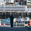 Desi Smith /Gloucester Daily Times.   A man stops to take in the sights of Rockport Harbor from Bradley Wharf on a cold Friday afternoon.<br />  February 28,2014.