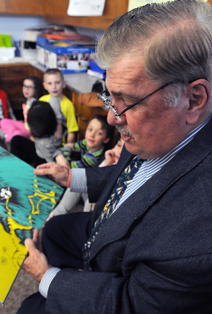Ken Yuszkus/Staff photo: Gloucester: Councilor At Large Bob Whynott reads Dr. Seuss' The Sleep Book to Adrienne Cormier's 2nd grade class at the West Parish School in Gloucester as part of the Dr. Seuss Day program at the school.