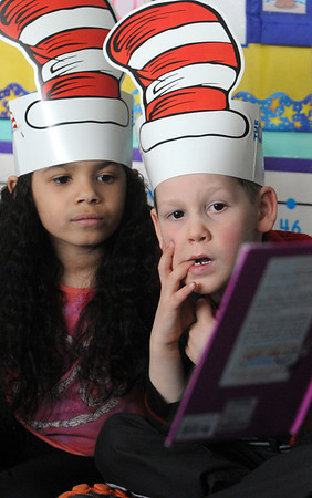 Ken Yuszkus/Staff photo: Gloucester:  Jalessa Middleon and Matthew Rex listen to dental assistant Lisa Borowick read Dr. Seuss' The Tooth Book at the West Parish School in Gloucester as part of the Dr. Seuss Day program at the school. The two students are in Jaclyn Figurido's kindergarten class.