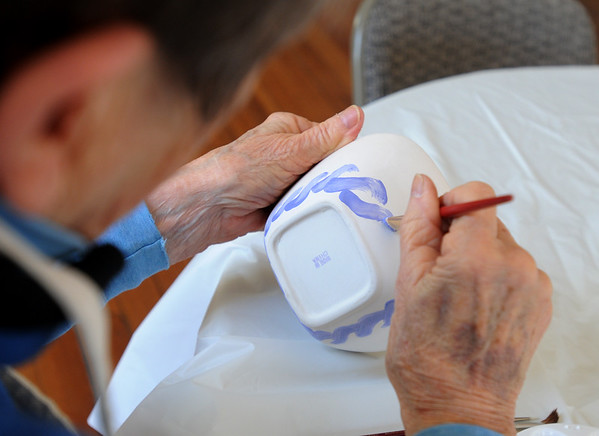 PAUL BILODEAU/Staff photo. Jane Moginot of Rockport works on her bowl at an Open Door bowl painting event at the Rockport Senior Center.